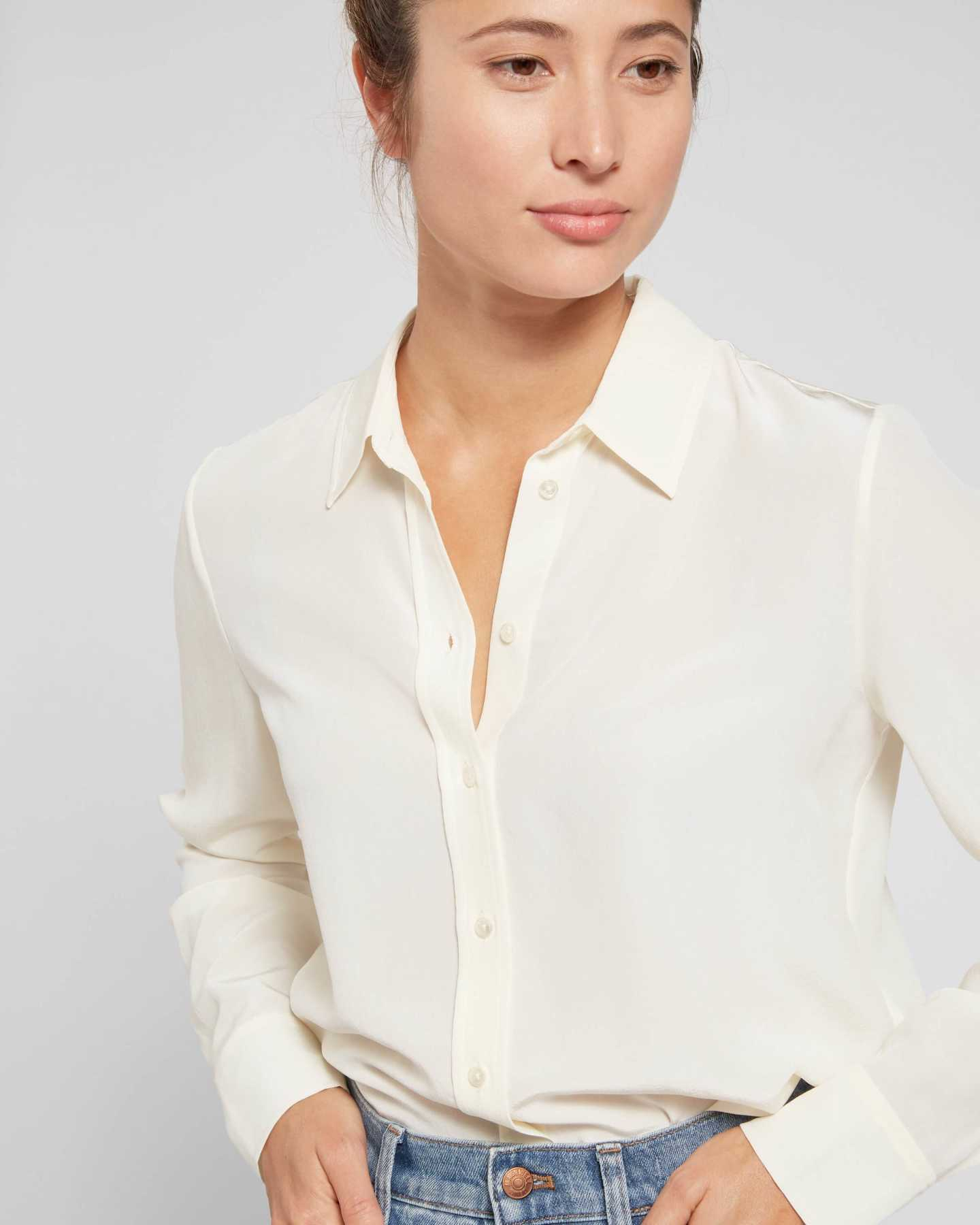 Woman wearing womens silk blouse in ivory from front