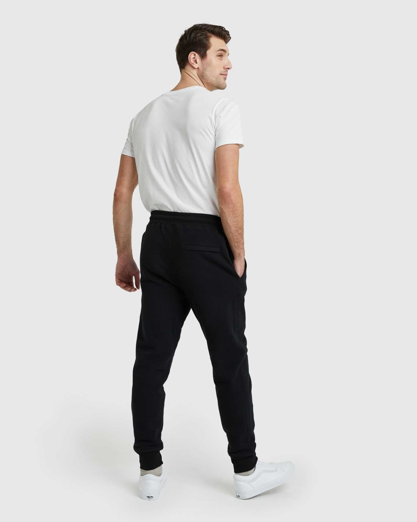 Man wearing 100% organic cotton heavyweight sweatpants in black posing