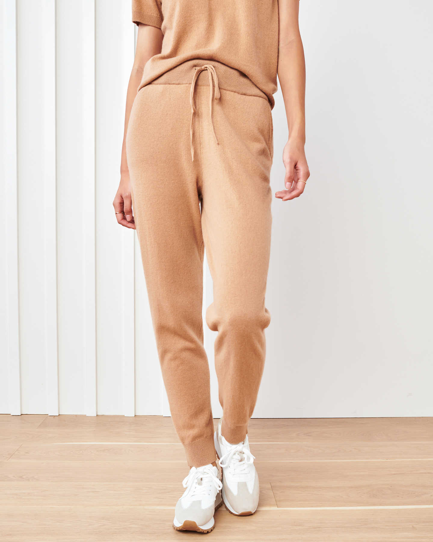 Woman wearing camel cashmere sweatpants, cashmere joggers and hoodie