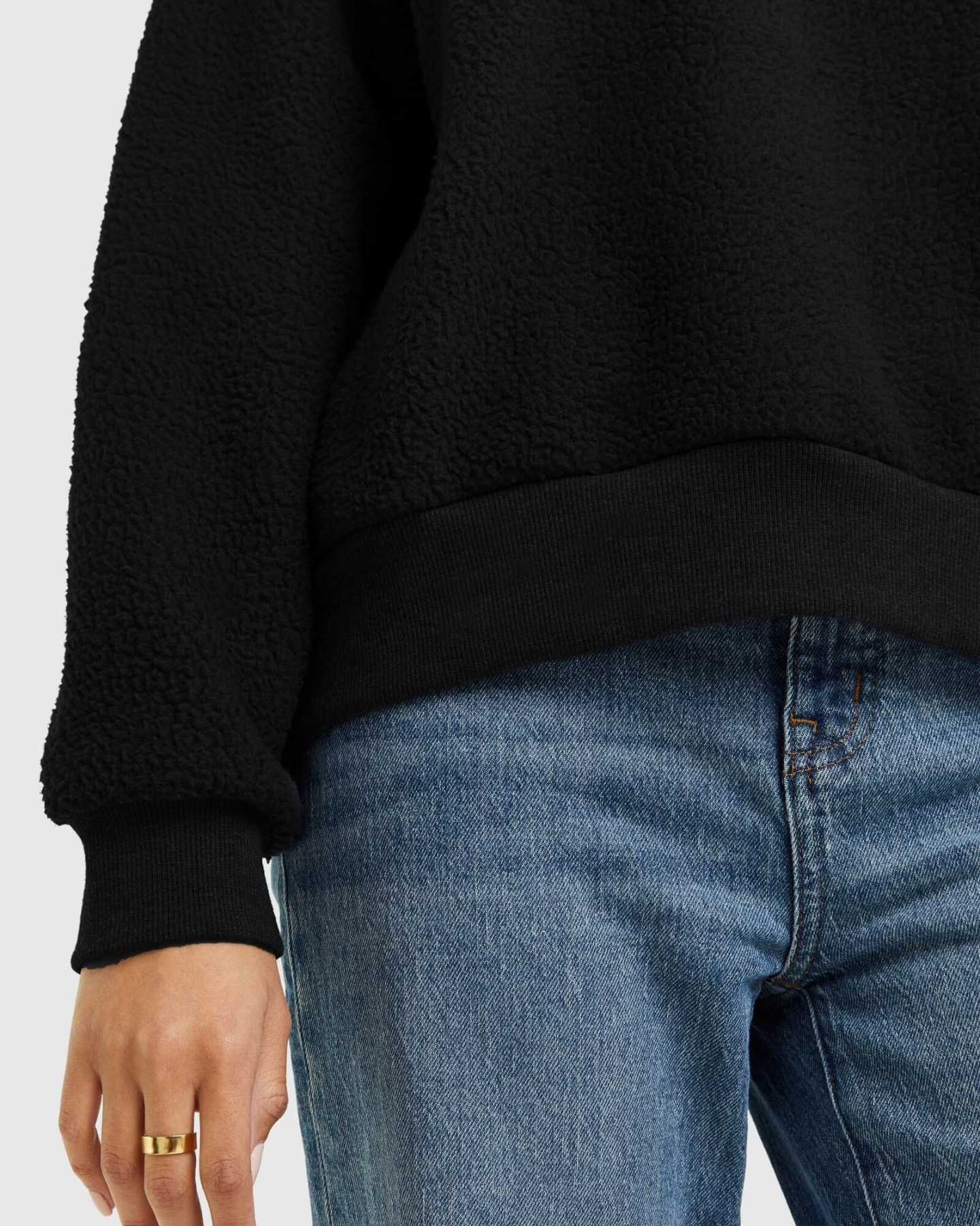 woman wearing sherpa crewneck sweatshirt in black zoomed in