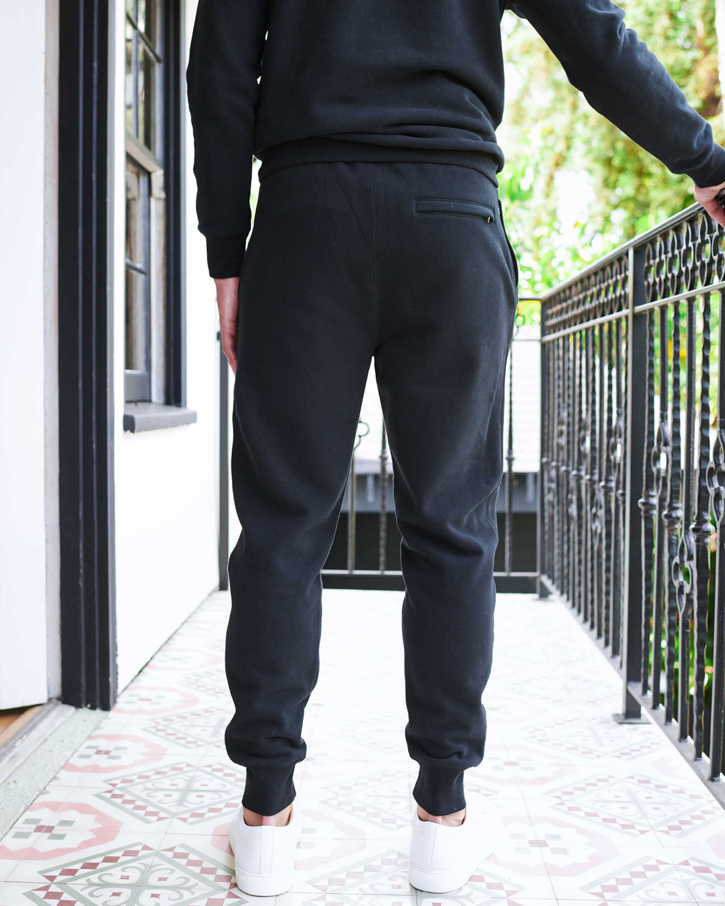 Man wearing 100% organic cotton heavyweight sweatpants in black from back