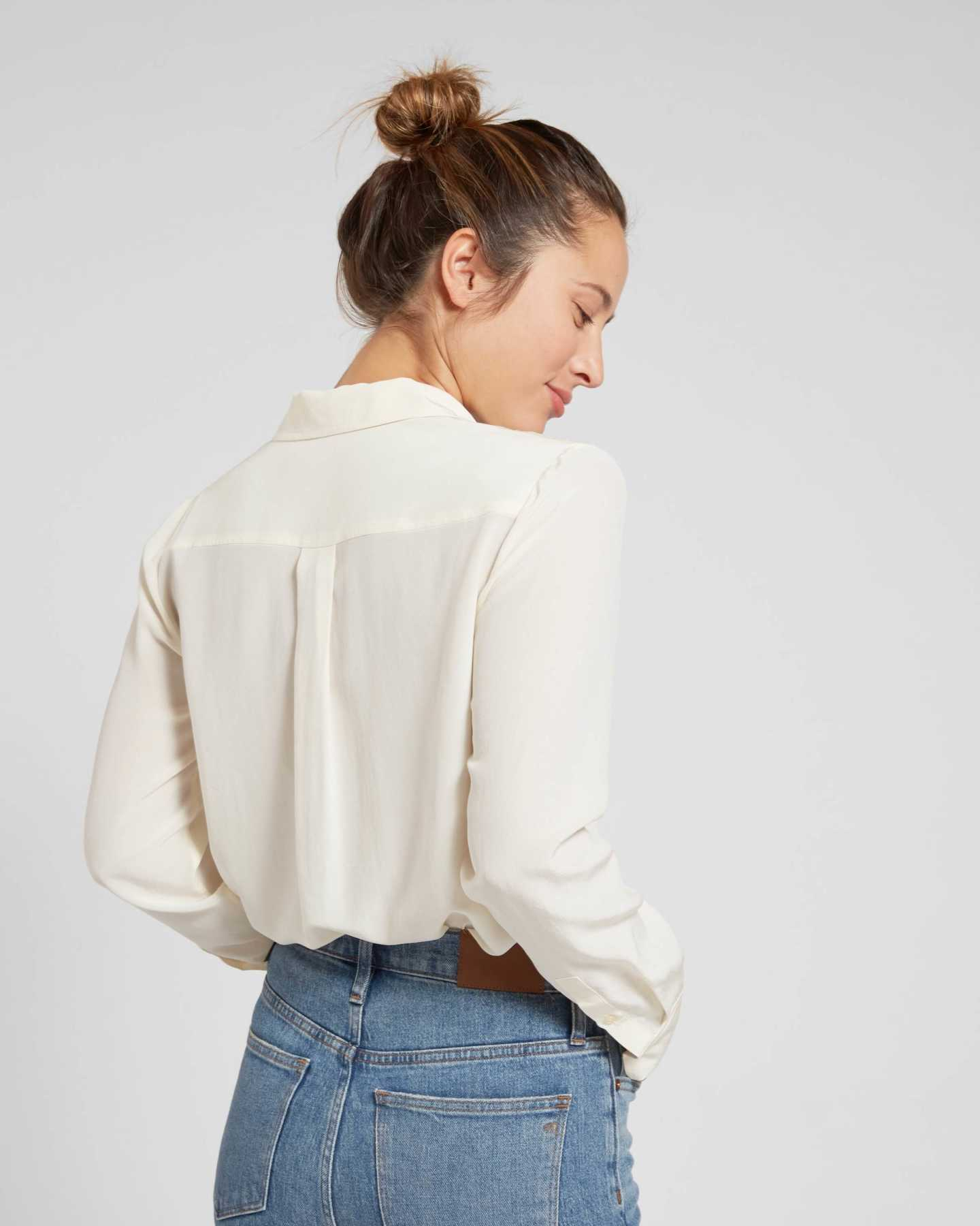 Woman wearing womens silk blouse in ivory from side