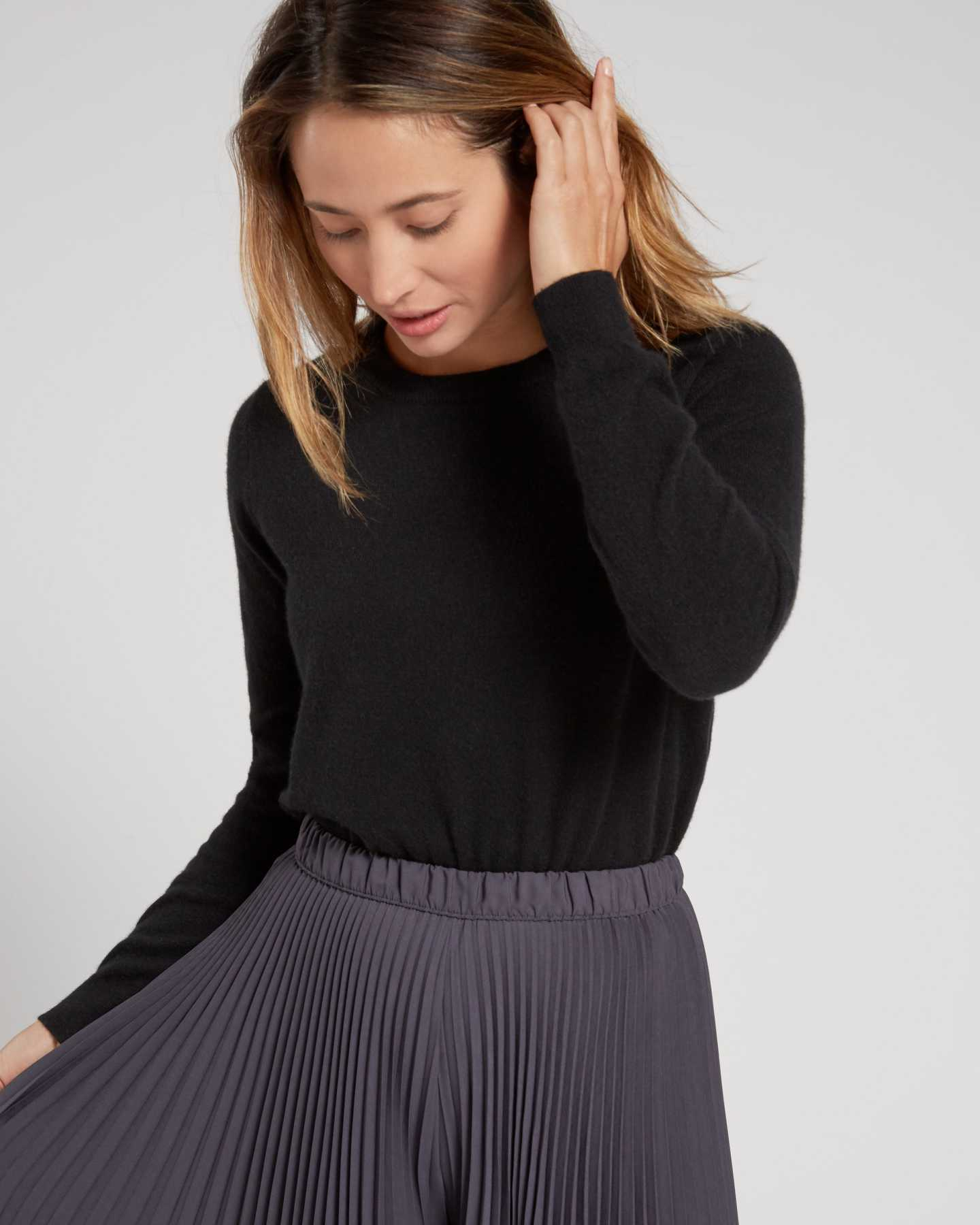 black cashmere sweater women looking down