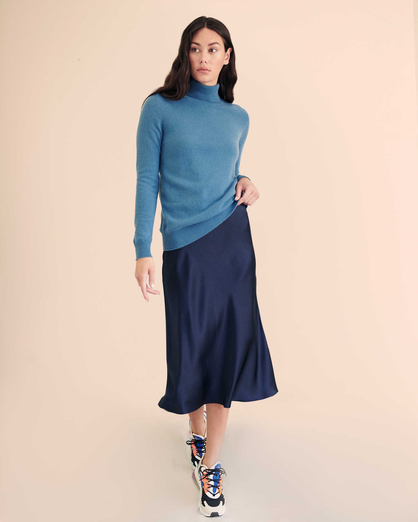 Woman wearing navy silk skirt