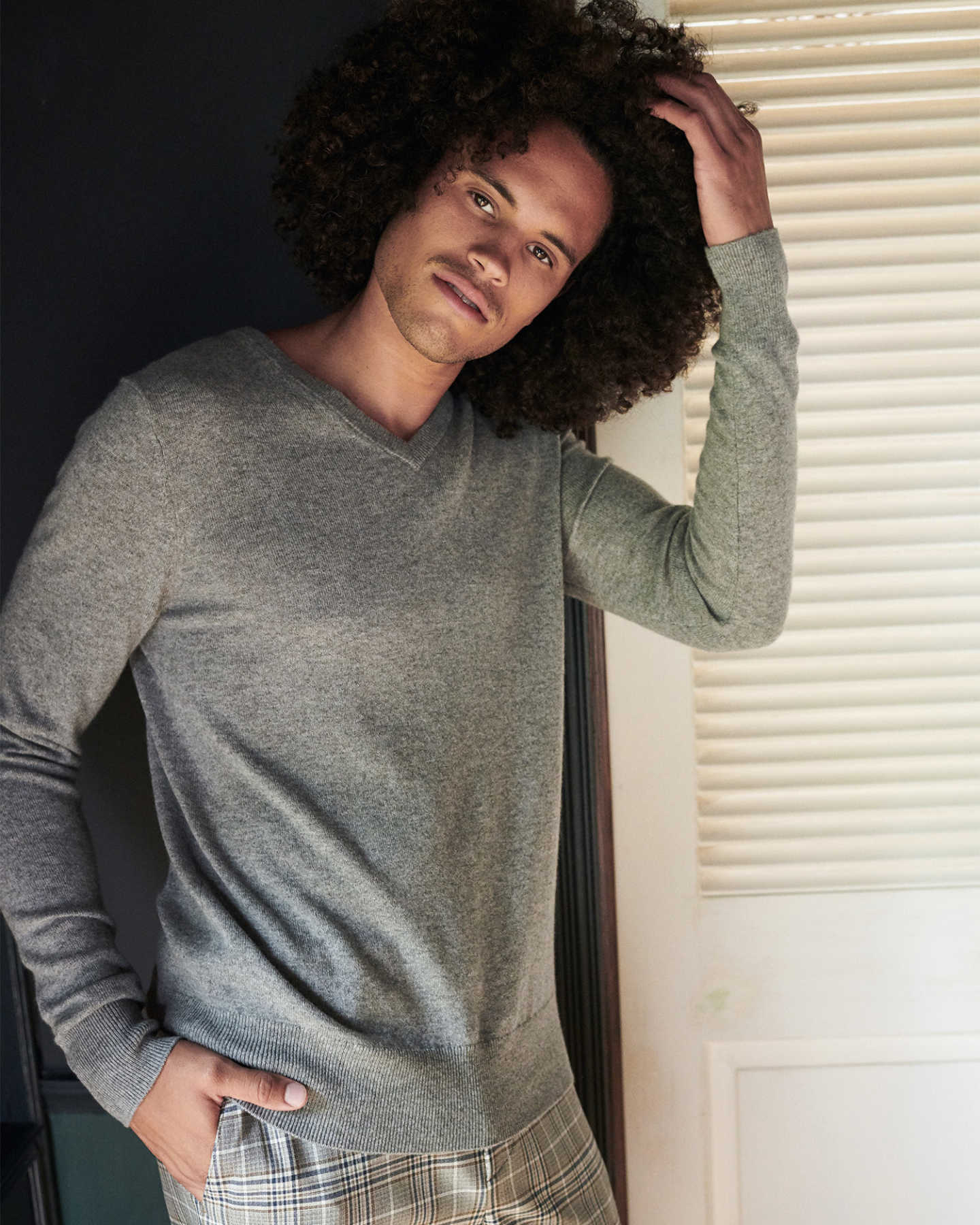 Man wearing grey cashmere v-neck sweater