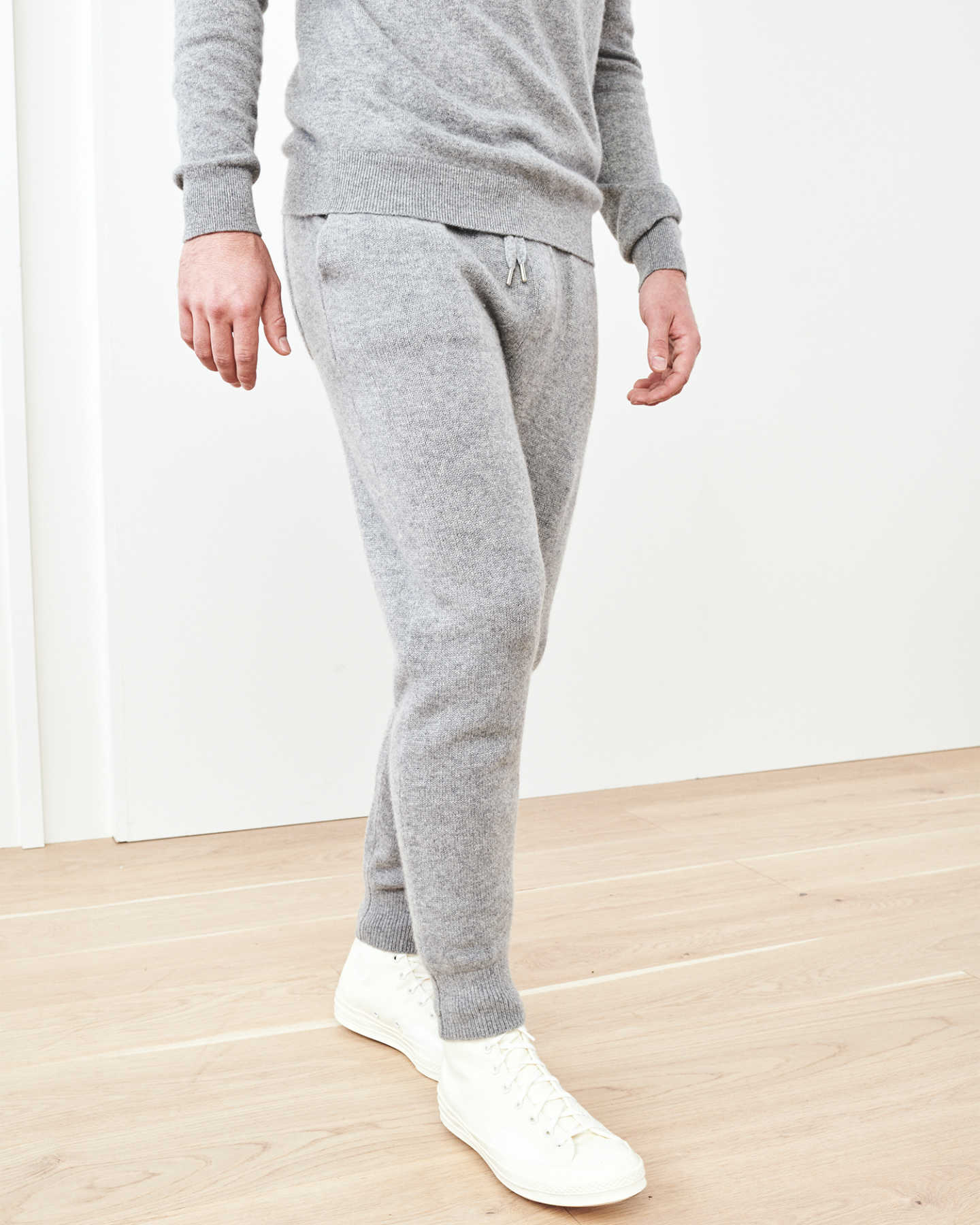 Man wearing cashmere men's cashmere joggers / cashmere sweatpants in grey walking