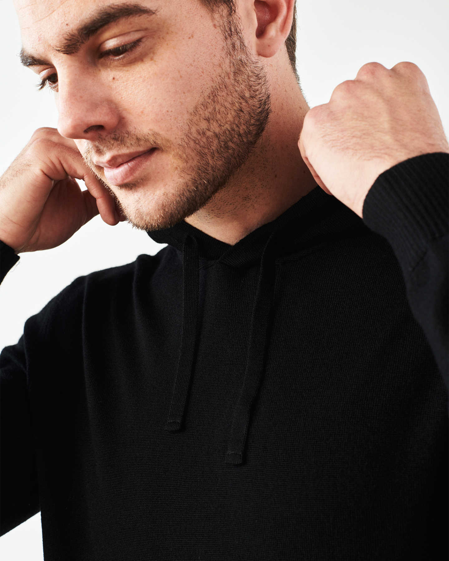 Man wearing merino wool hoodie in black zoomed in