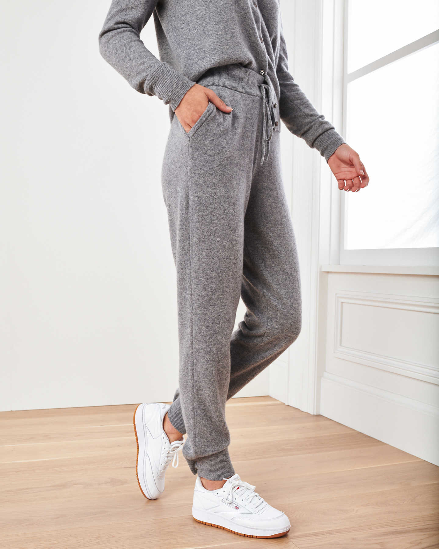 Woman wearing grey cashmere sweatpants & cashmere joggers