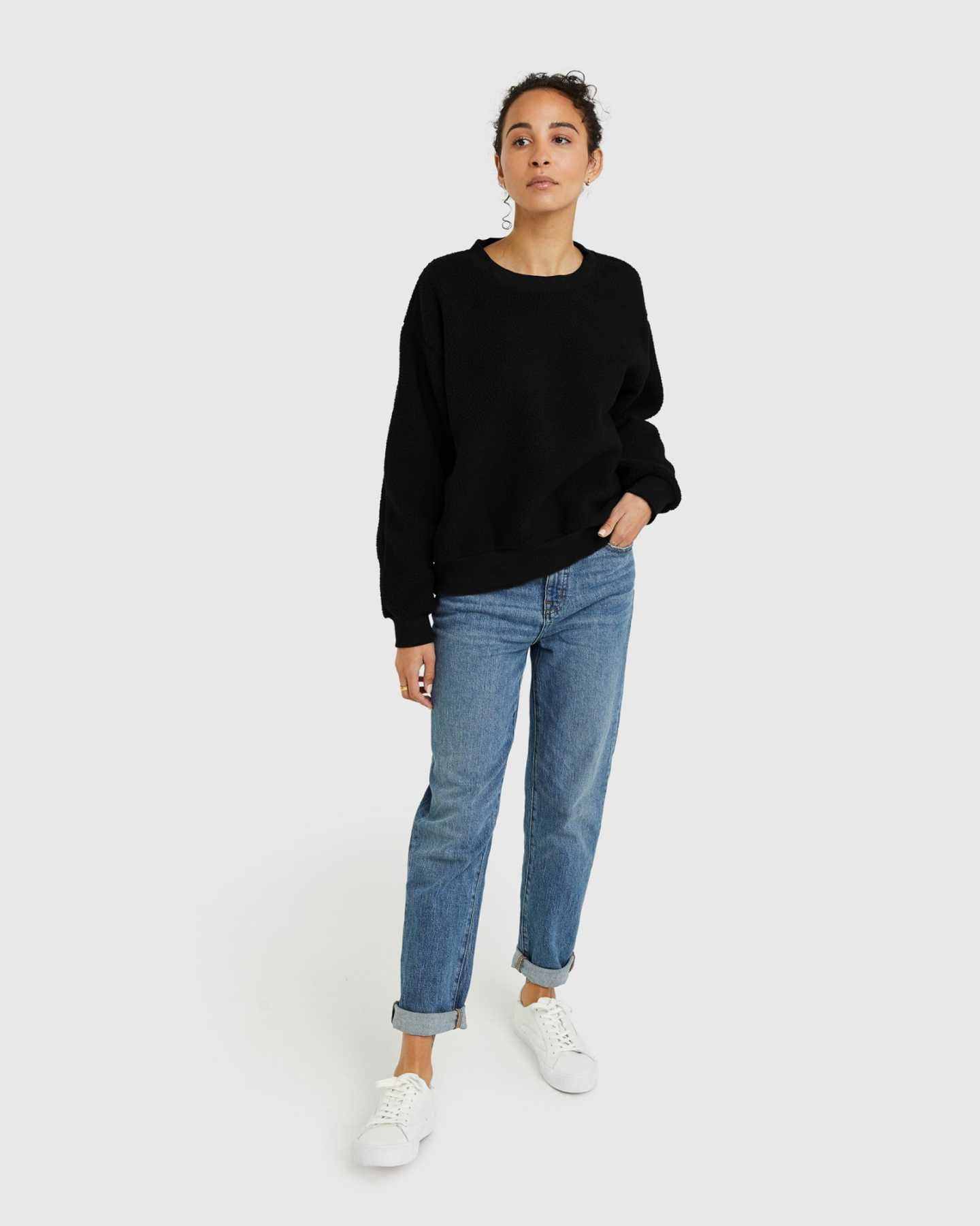 woman wearing sherpa crewneck sweatshirt in black