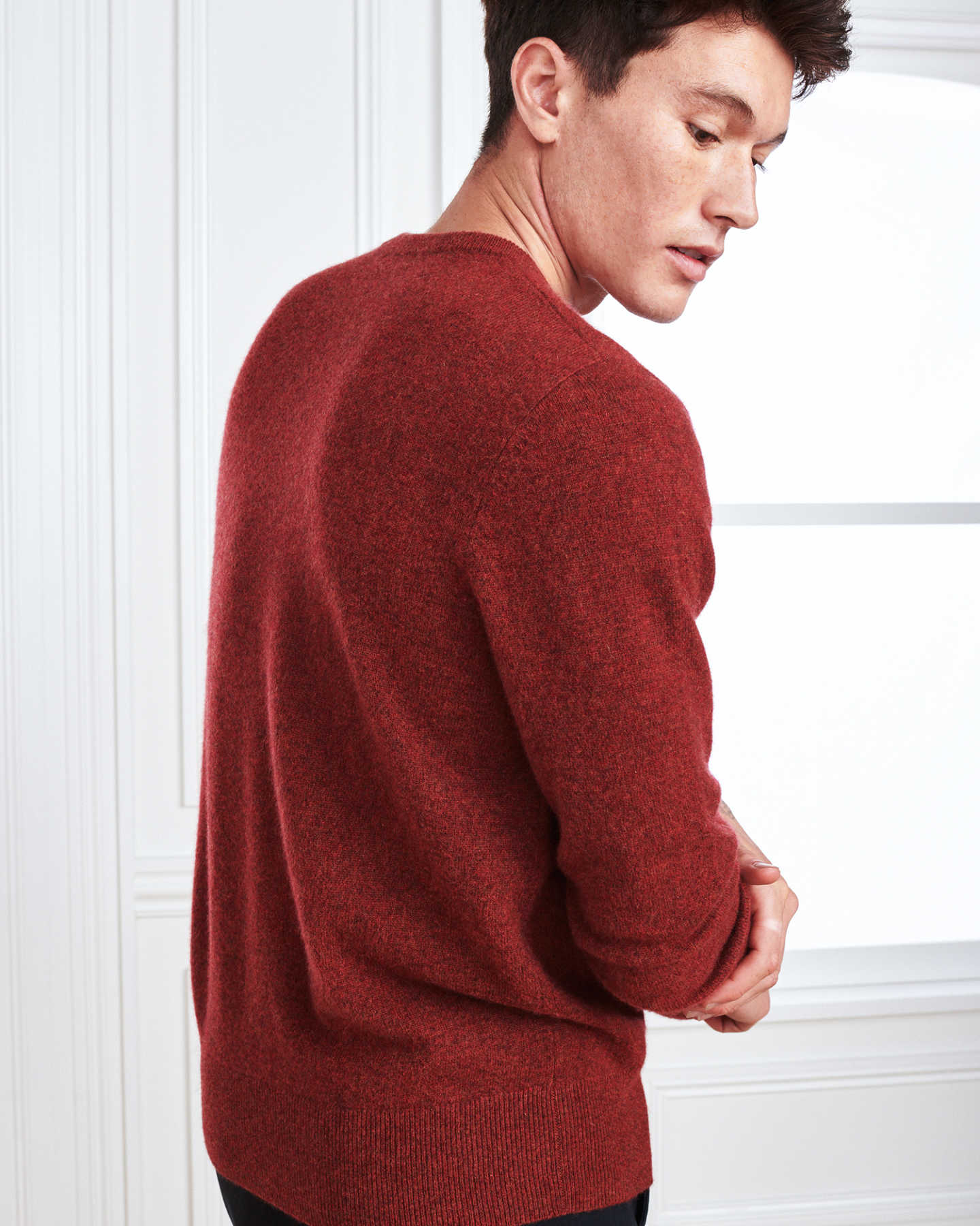 Man wearing red men's cashmere sweater from back