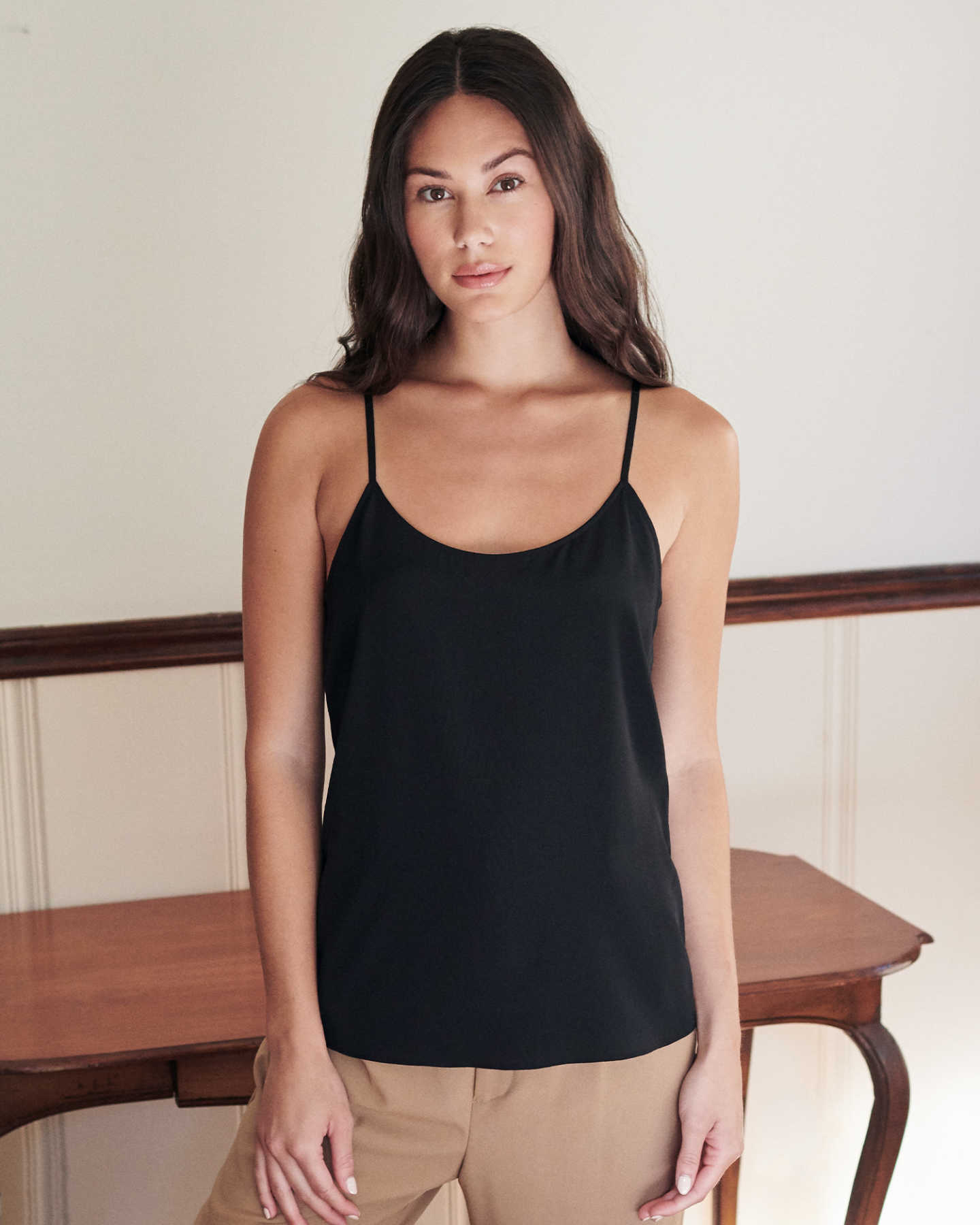 woman wearing silk camisole in black
