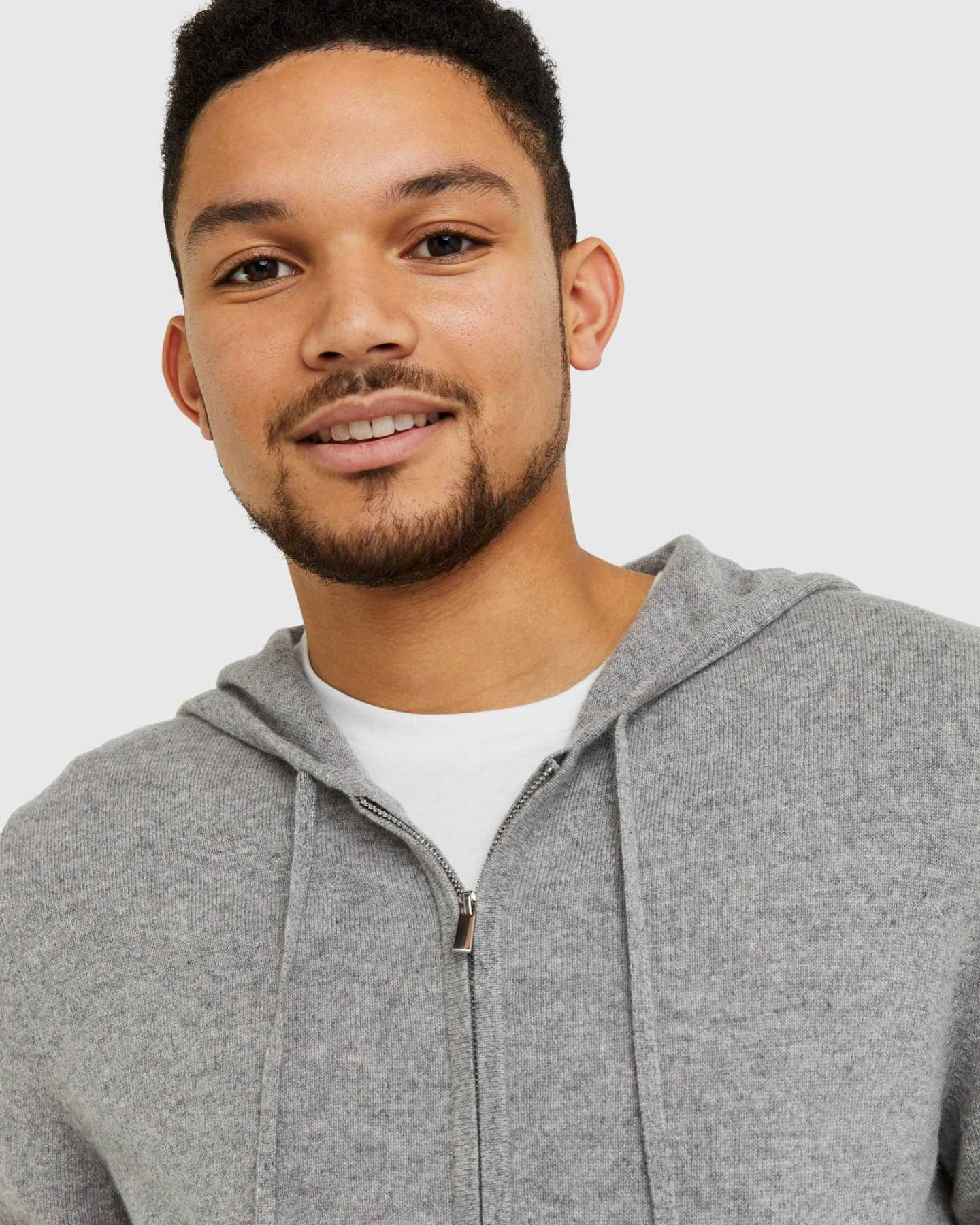 mens cashmere zip hoodie in grey smiling