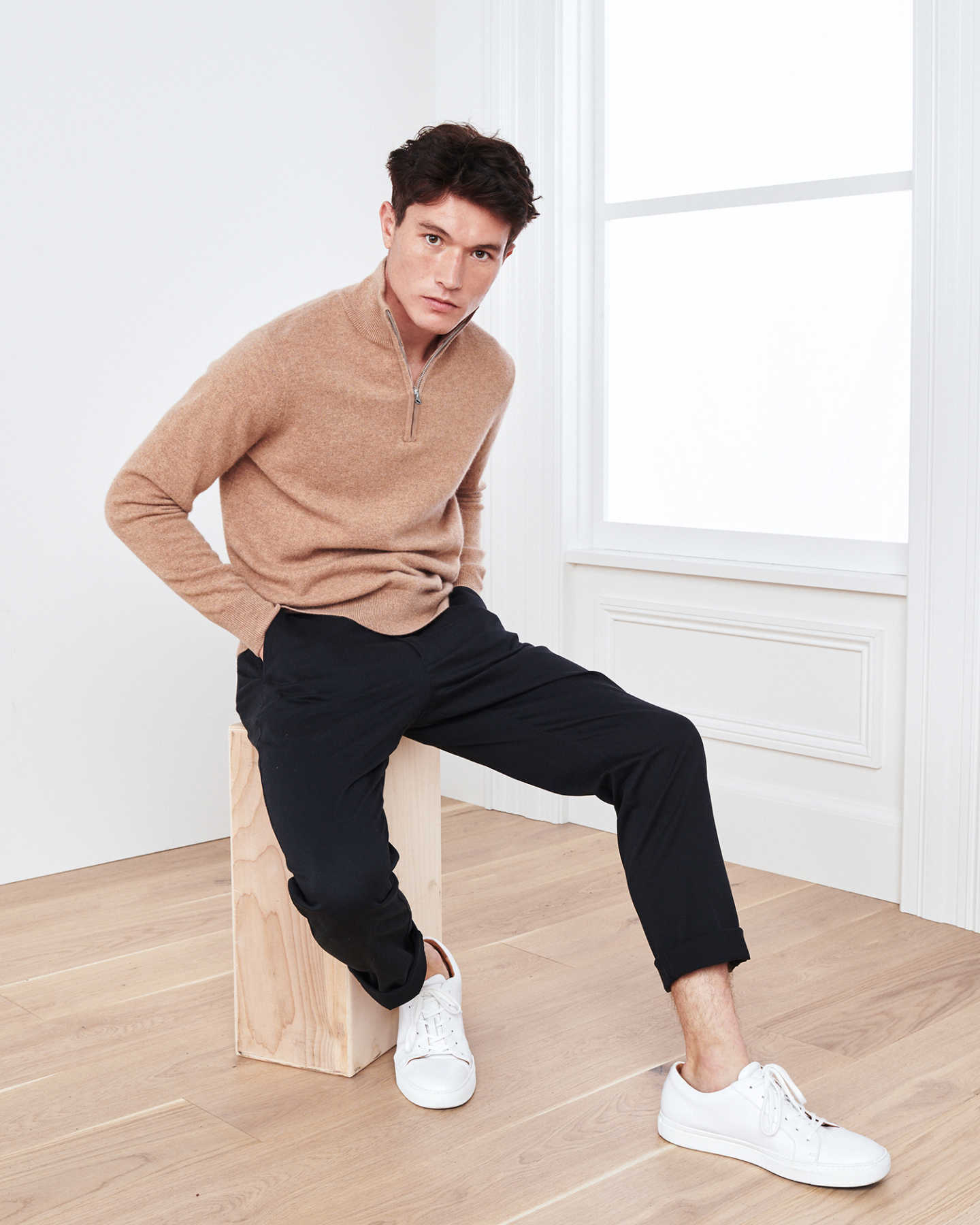 Man wearing camel cashmere quarter zip sweater