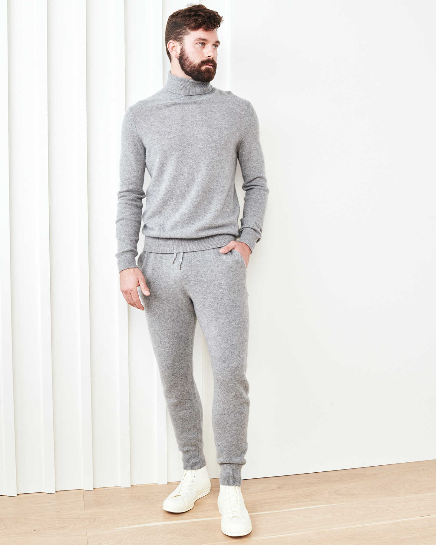 Man wearing cashmere men's cashmere joggers / cashmere sweatpants in grey and grey men's cashmere sweater