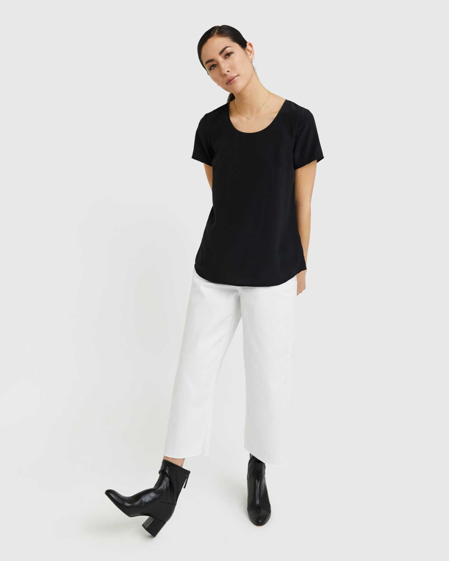 Woman wearing silk tee in black