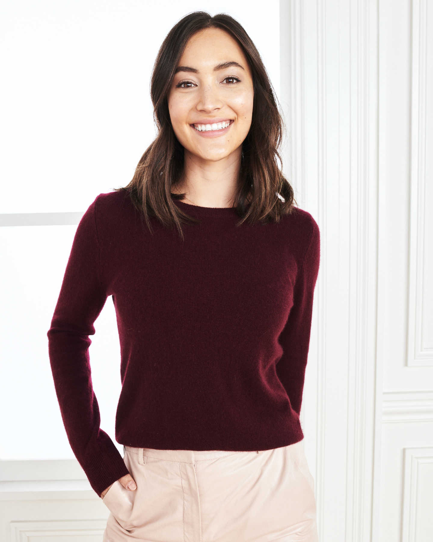 Woman wearing baby cashmere sweater in burgundy