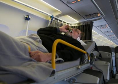 Elderly Man in Stretcher