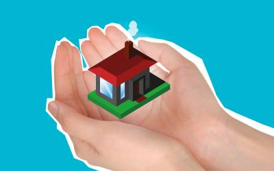 Insurance policy hands holding home