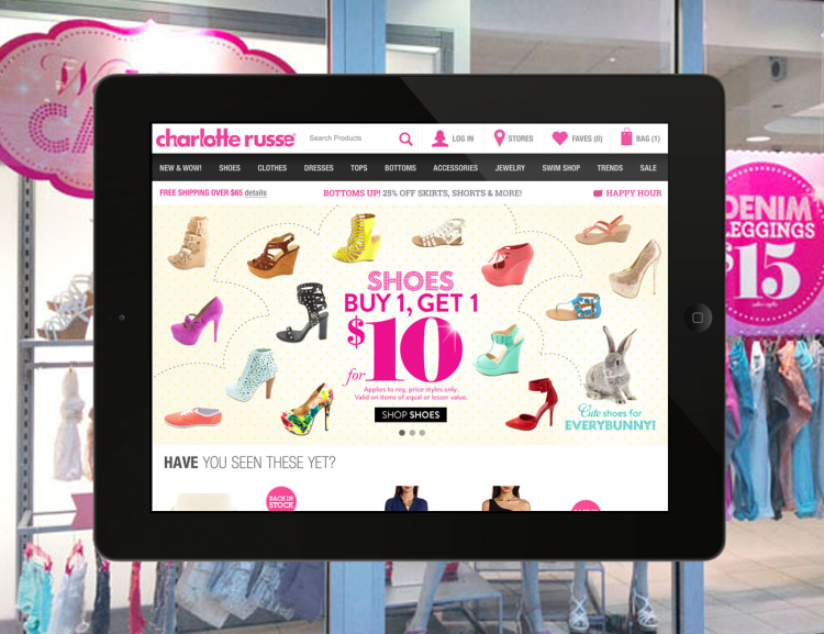 Charlotte Russe website shown on tablet device with merchandise in the background