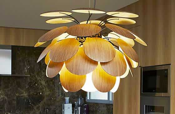 Modern light fixture hanging in kitchen