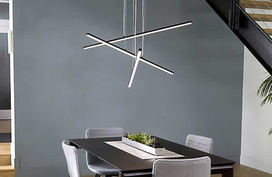 Modern chandelier hanging above a table