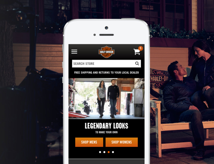 Harley Davidson website shown on mobile device with motorcycles in the background