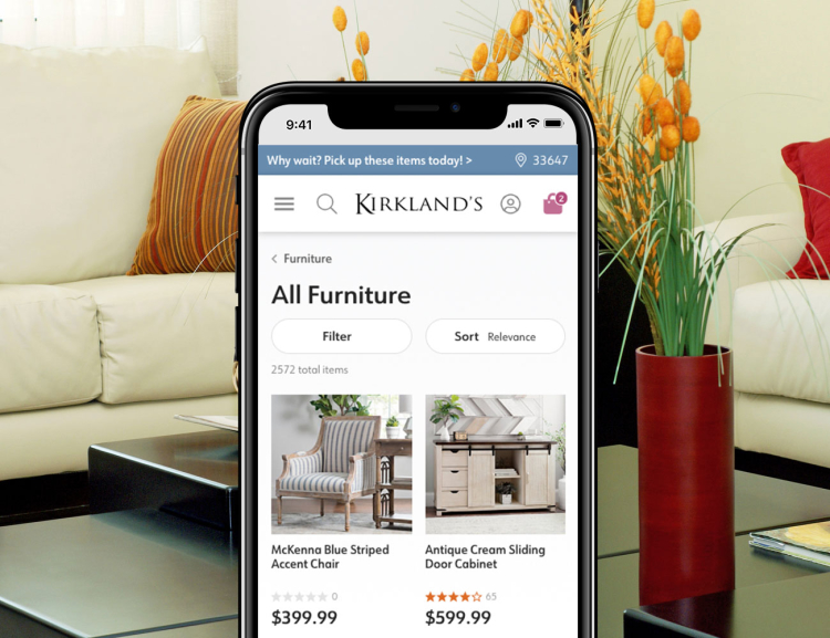 Kirklands website shown on mobile device with living room background