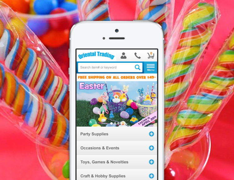 Oriental Trading website shown on mobile device with candy in the background