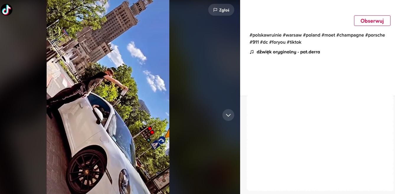 Fani zobaczyli, jak białe Porsche polewane jest drogim szampanem