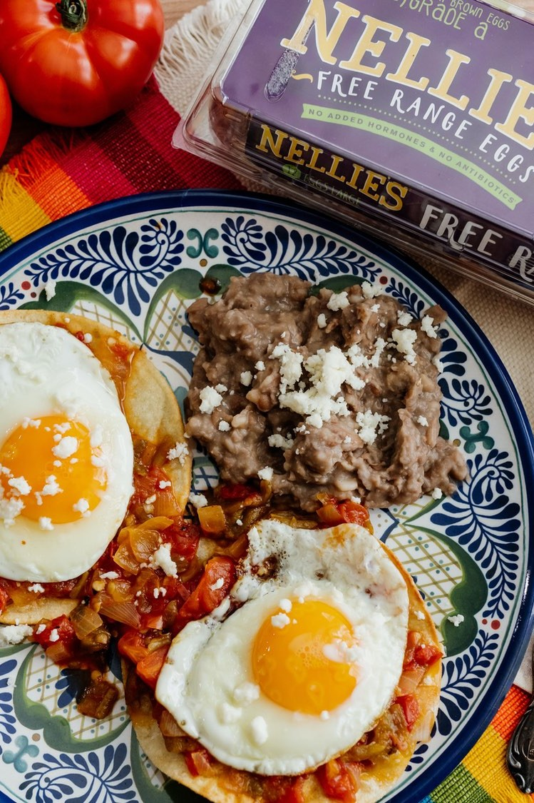 Huevos Rancheros topped with two Nellie's Free Range Eggs.