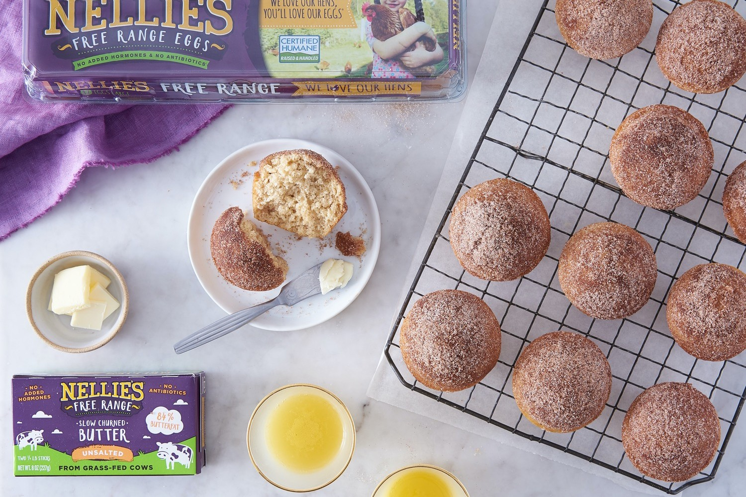 Simple, easy, kid-friendly, dump-and-stir donut muffins dunked in a cinnamon-sugar topping. | nelliesfreerangeeggs.com