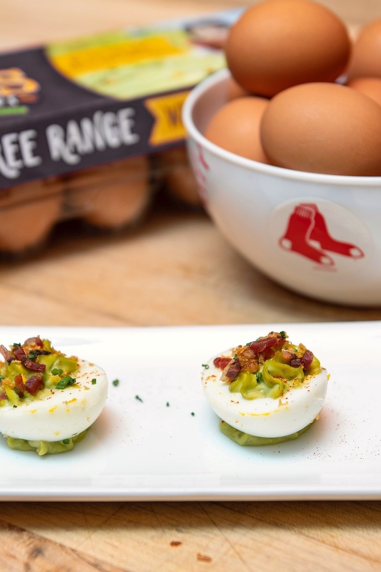 Bright and savory Boston Red Sox inspired deviled eggs made with avocado, chives, lime, and bacon bits. | nelliesfreerange.com