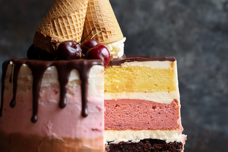 Crowd-pleasing, triple-threat Neapolitan cake recipe made with layers of chocolate, strawberry, and vanilla. | nelliesfreerange.com