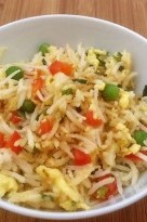 Quick and easy weeknight egg fried rice made with leftover cooked rice, mixed veggies, and free range eggs. | nelliesfreerange.com