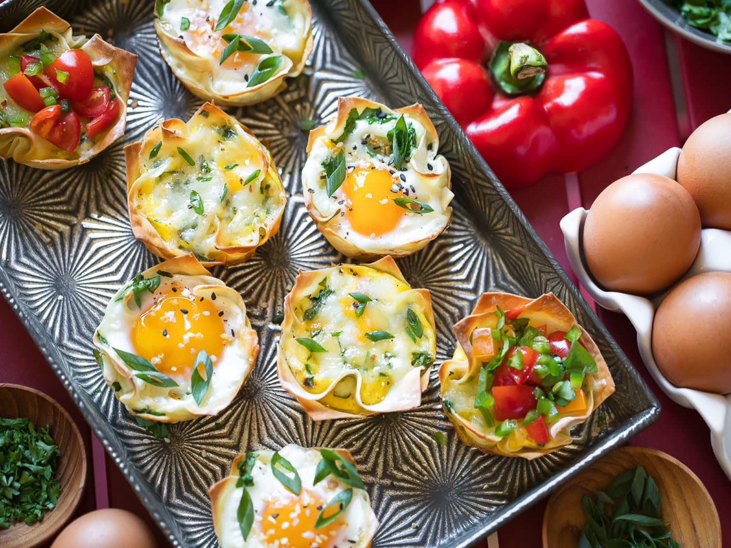 Fun, protein-packed, make ahead-friendly wonton egg cups recipe for delicious hand-held breakfast bites. | nelliesfreerange.com