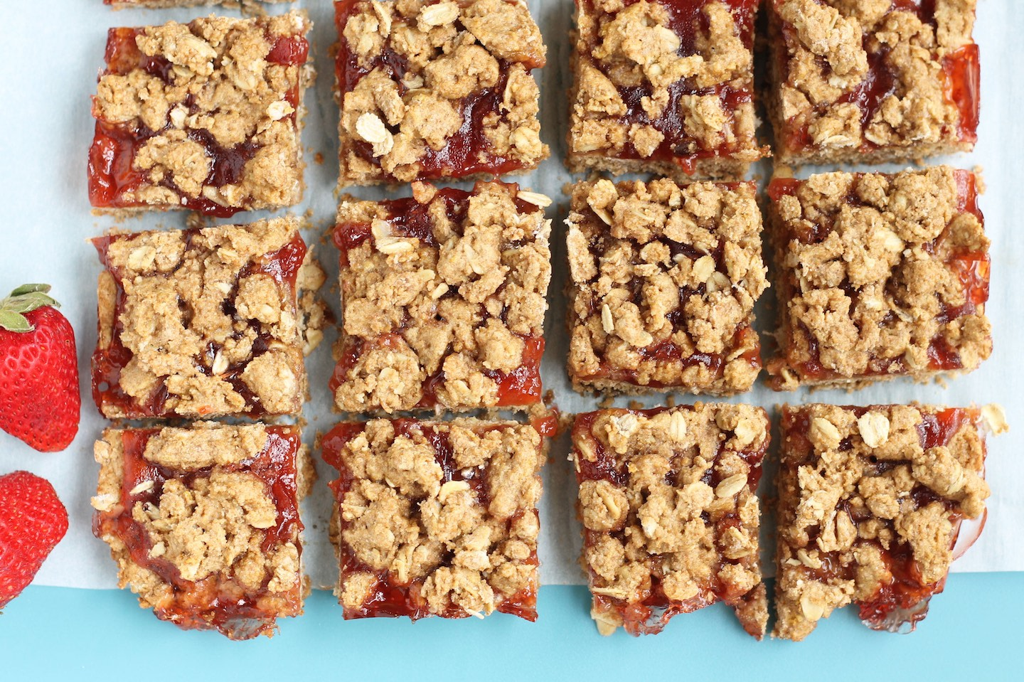 Sweet and easy strawberry oatmeal cookie bars featuring whole wheat flour and strawberry preserves. | nelliesfreerange.com