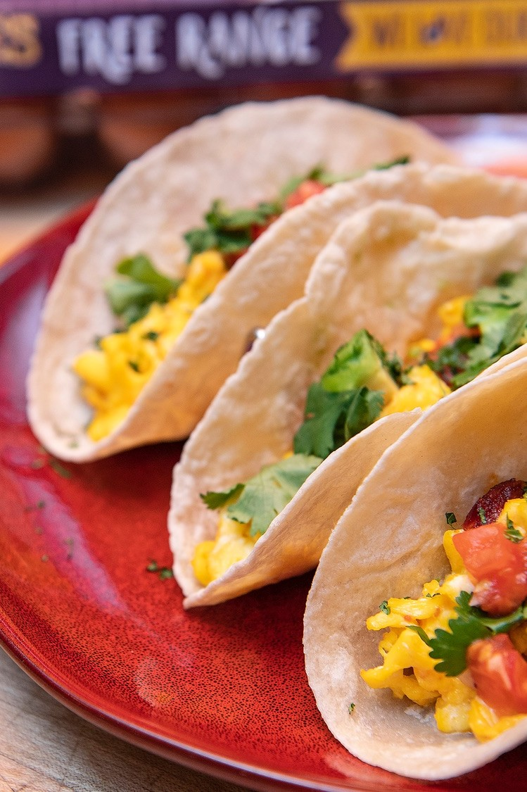 Flavorful breakfast tacos loaded with spicy chorizo, crispy potatoes, salsa, and scrambled free range eggs. | nelliesfreerange.com