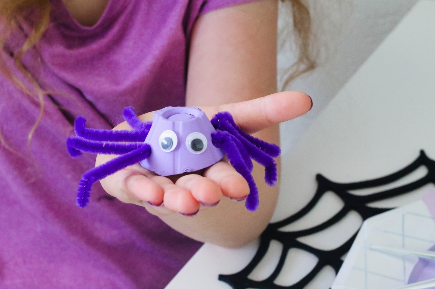 A creepy crawly purple spider made from upcycled Nellie's Free Range Egg cartons.