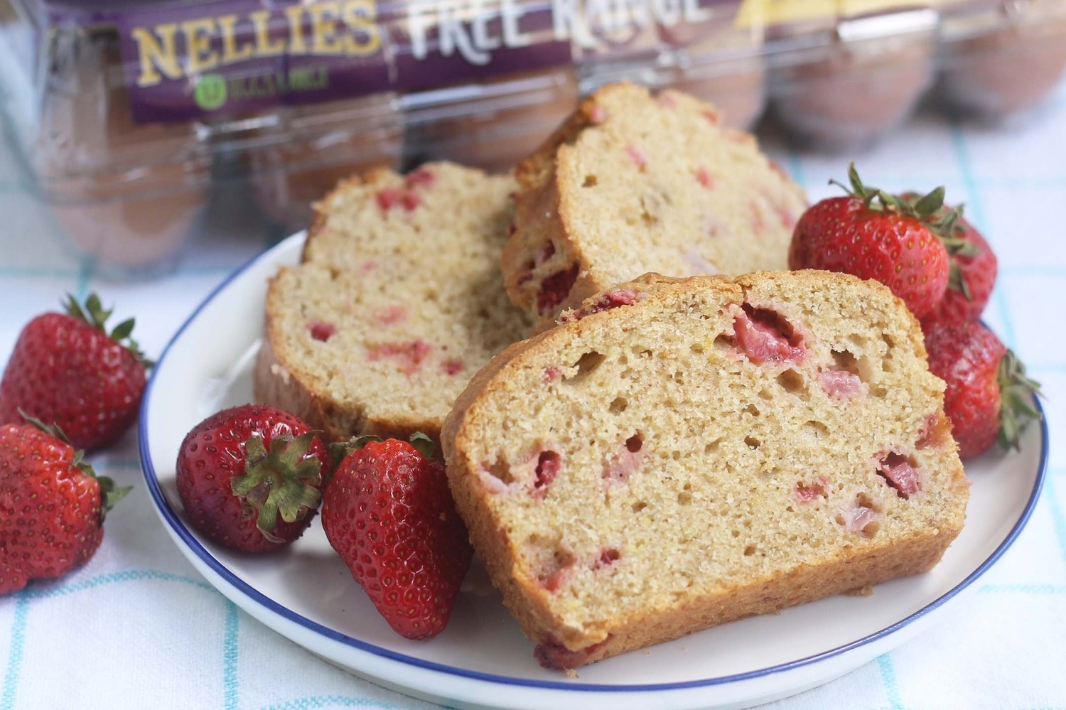 Super moist and kid-friendly strawberry banana quick bread recipe made with fresh strawberry pieces. | nelliesfreerange.com