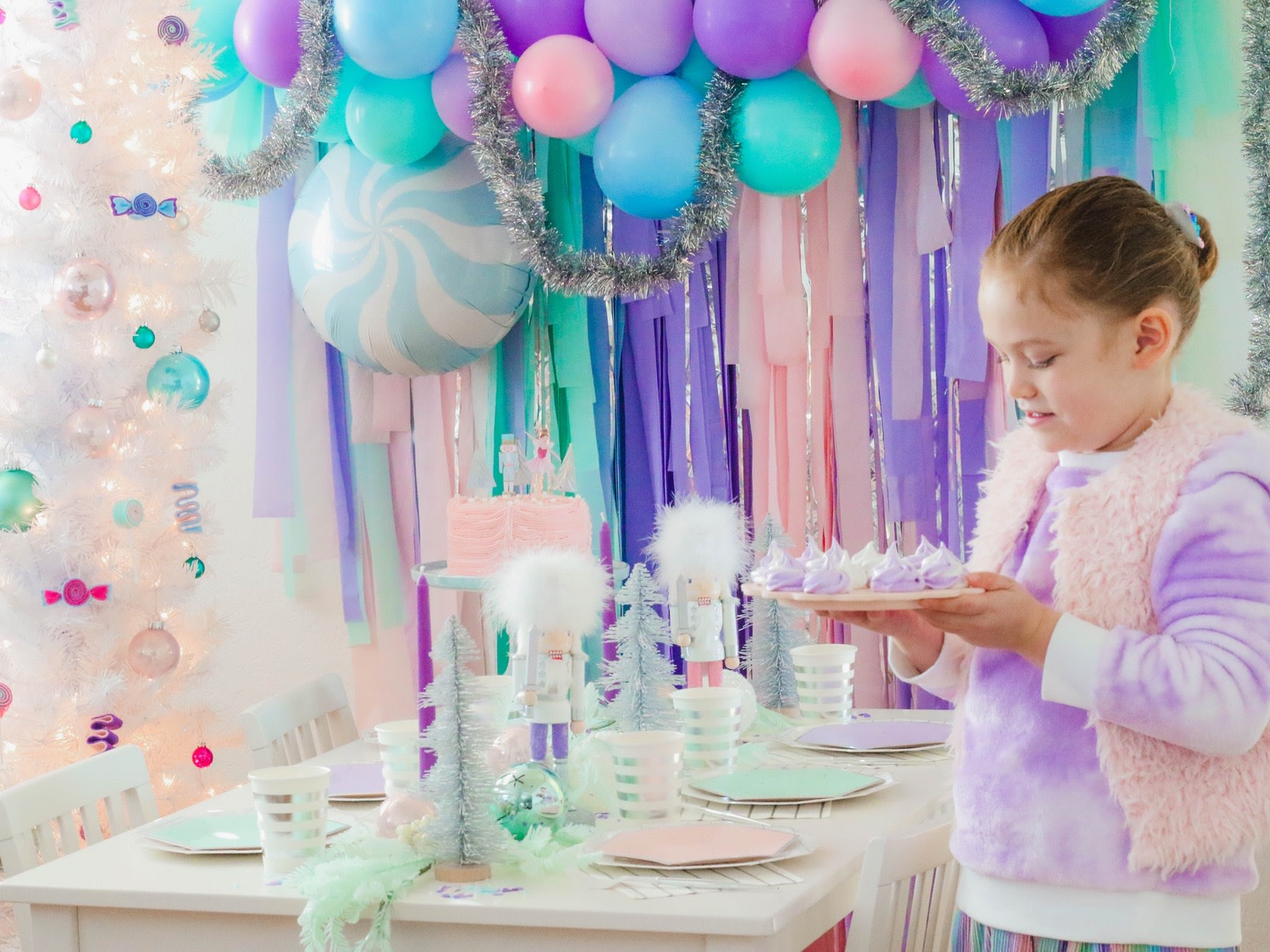 What could be sweeter than a holiday party inspired by the sugar plum fairy, complete with purple swirl meringue kisses and DIY lollipop ornaments made from upcycled egg cartons?