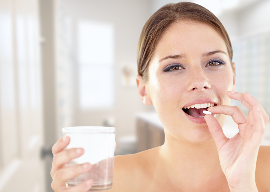 Woman with a vitamin pill and glass of water