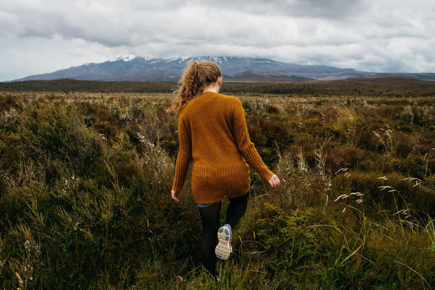woman orange sweater field