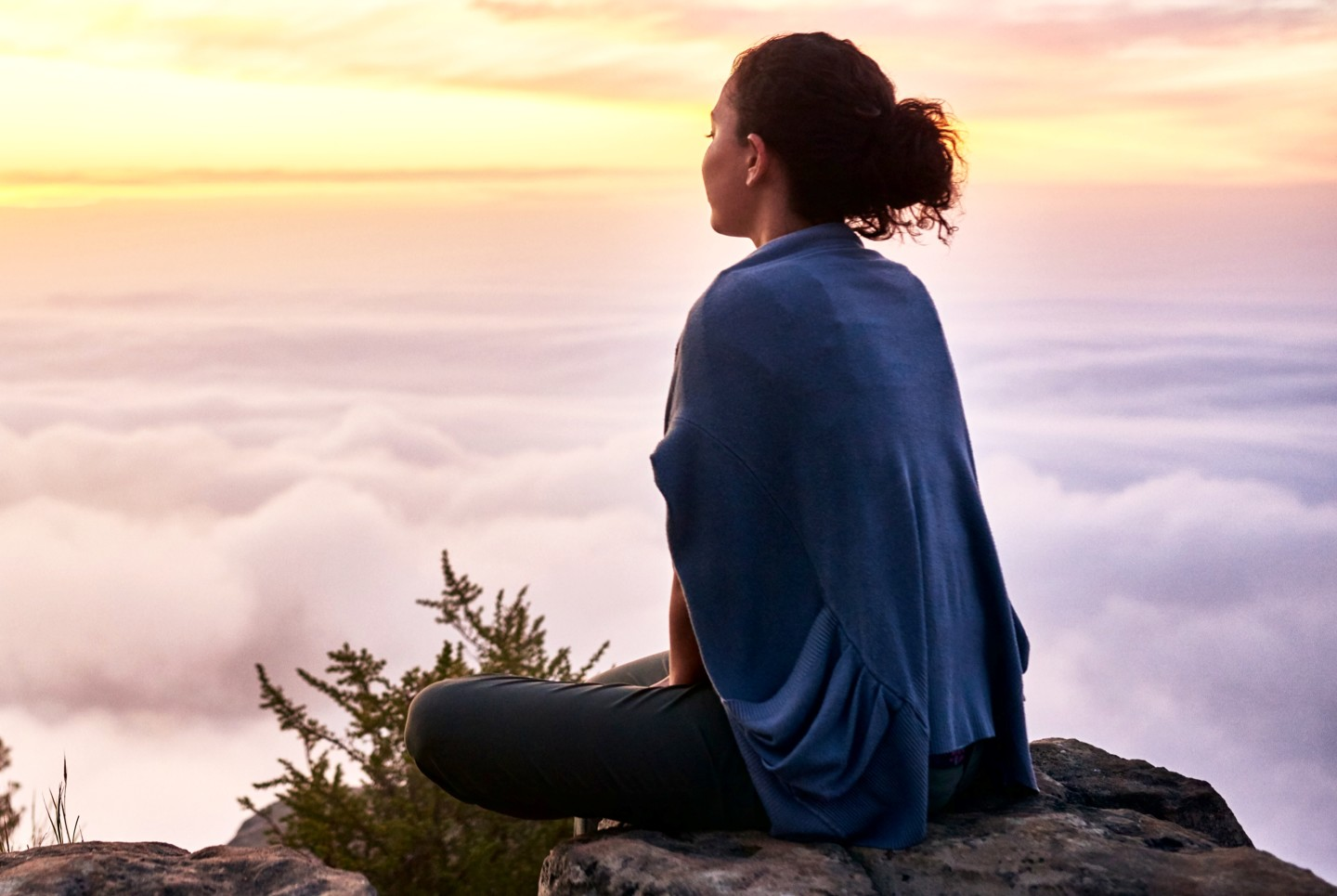 woman-sitting-above-clouds