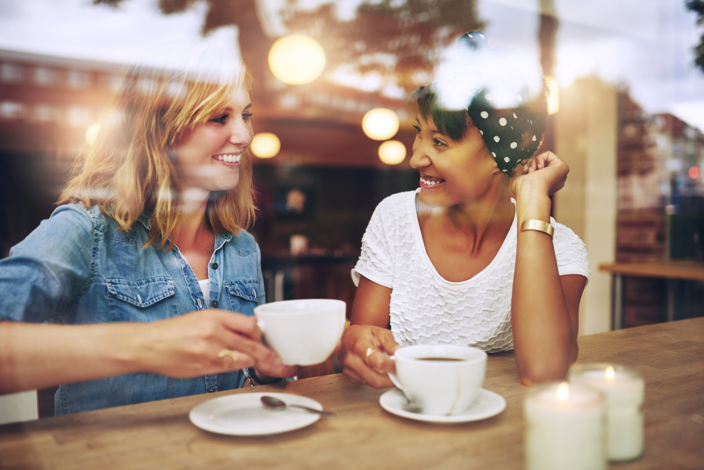 two-women-talking-coffee-shop