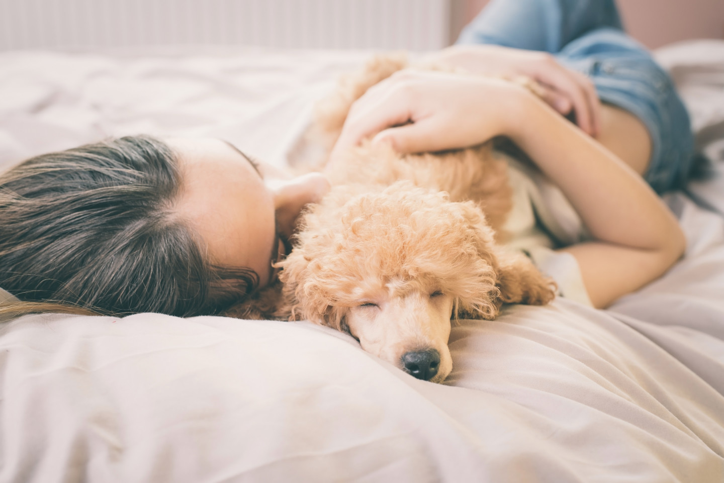 woman-in-bed-with-dog