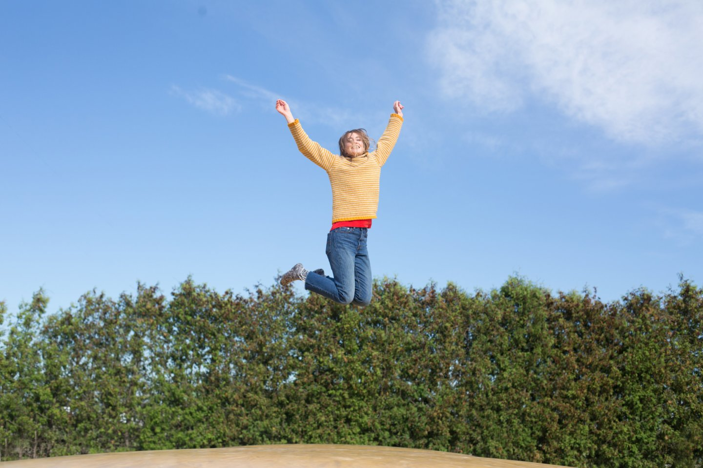 happy-woman-jumps-on-trampoline 4460x4460