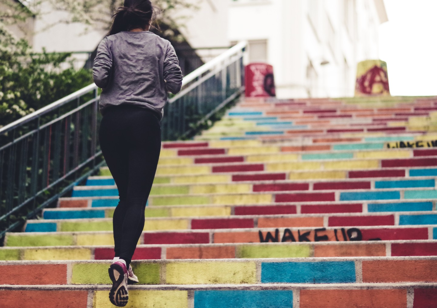 woman-running-up-colored-stairs