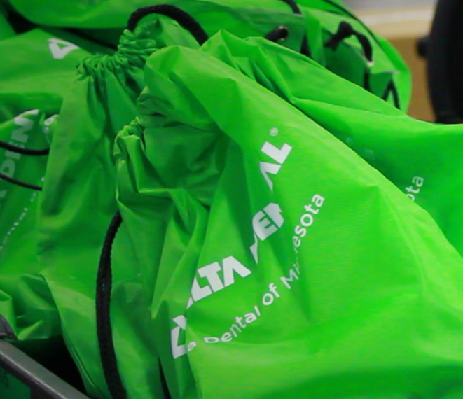 A pile of Delta Dental of Minnesota bags