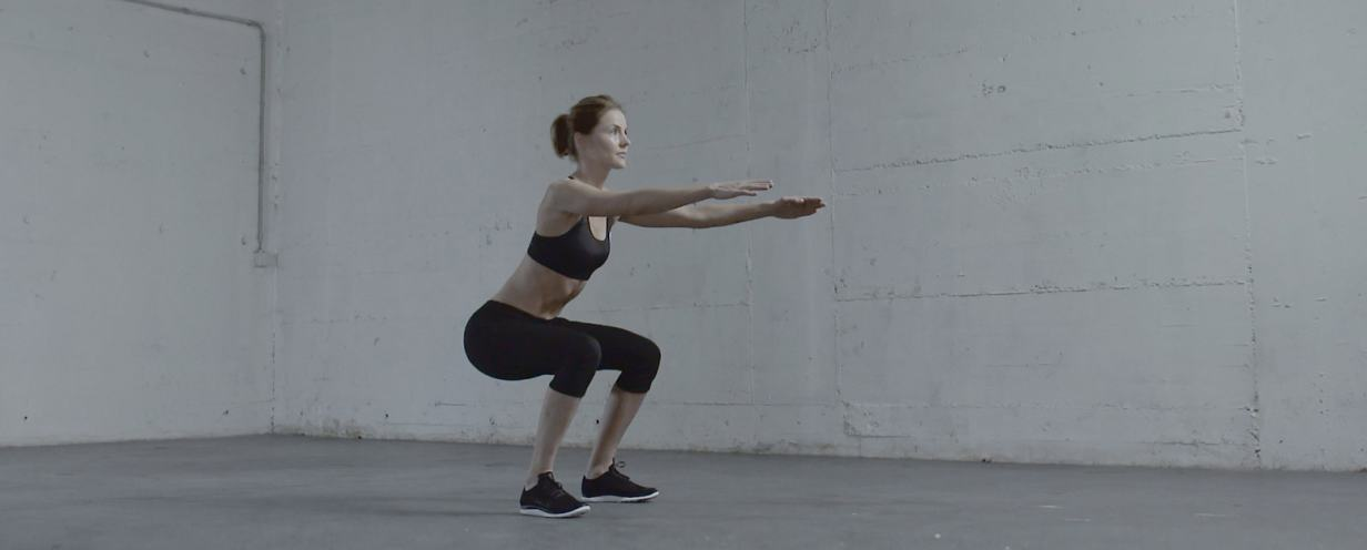 the woman doing a squat
