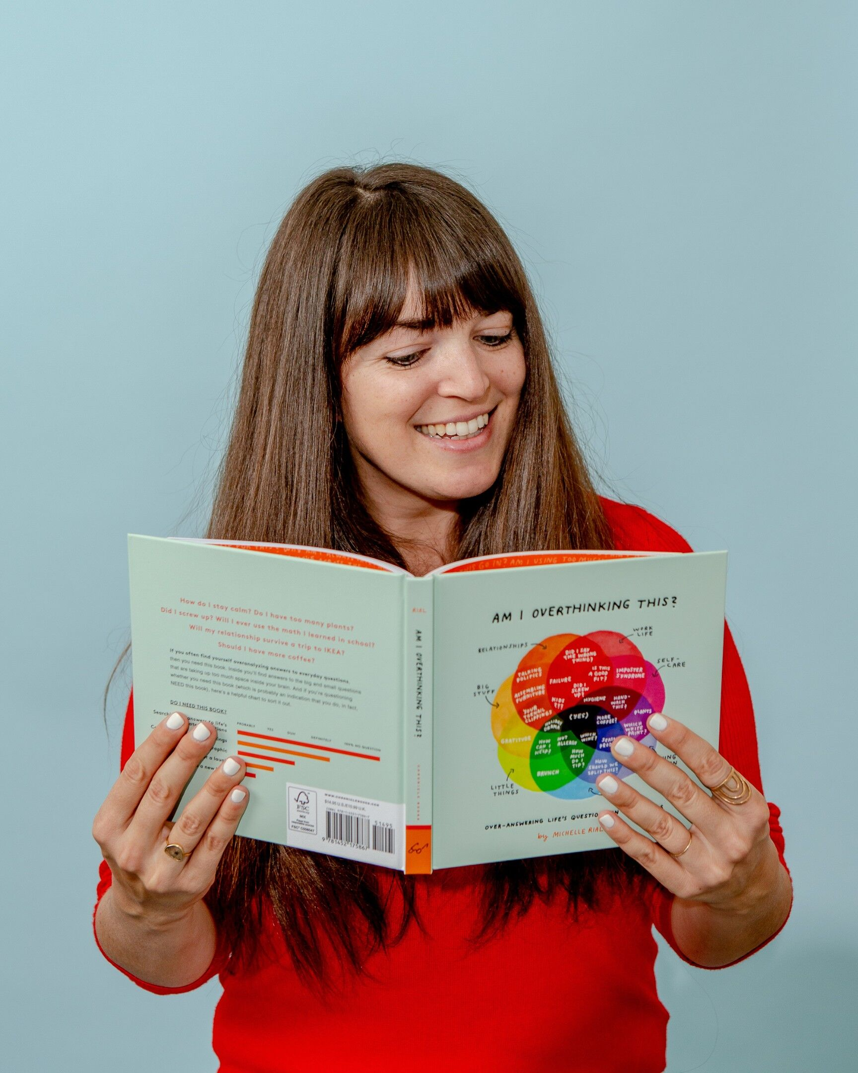 Michelle Rial with her book, Am I Overthinking This?